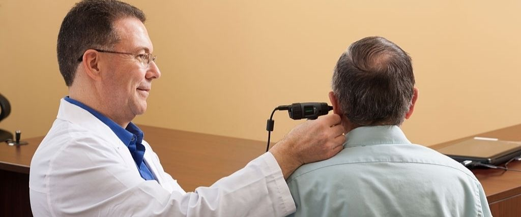 Audiologist doing a video ear canal inspection
